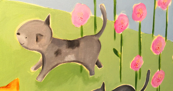 close-up detail of gray cat in pink flowers