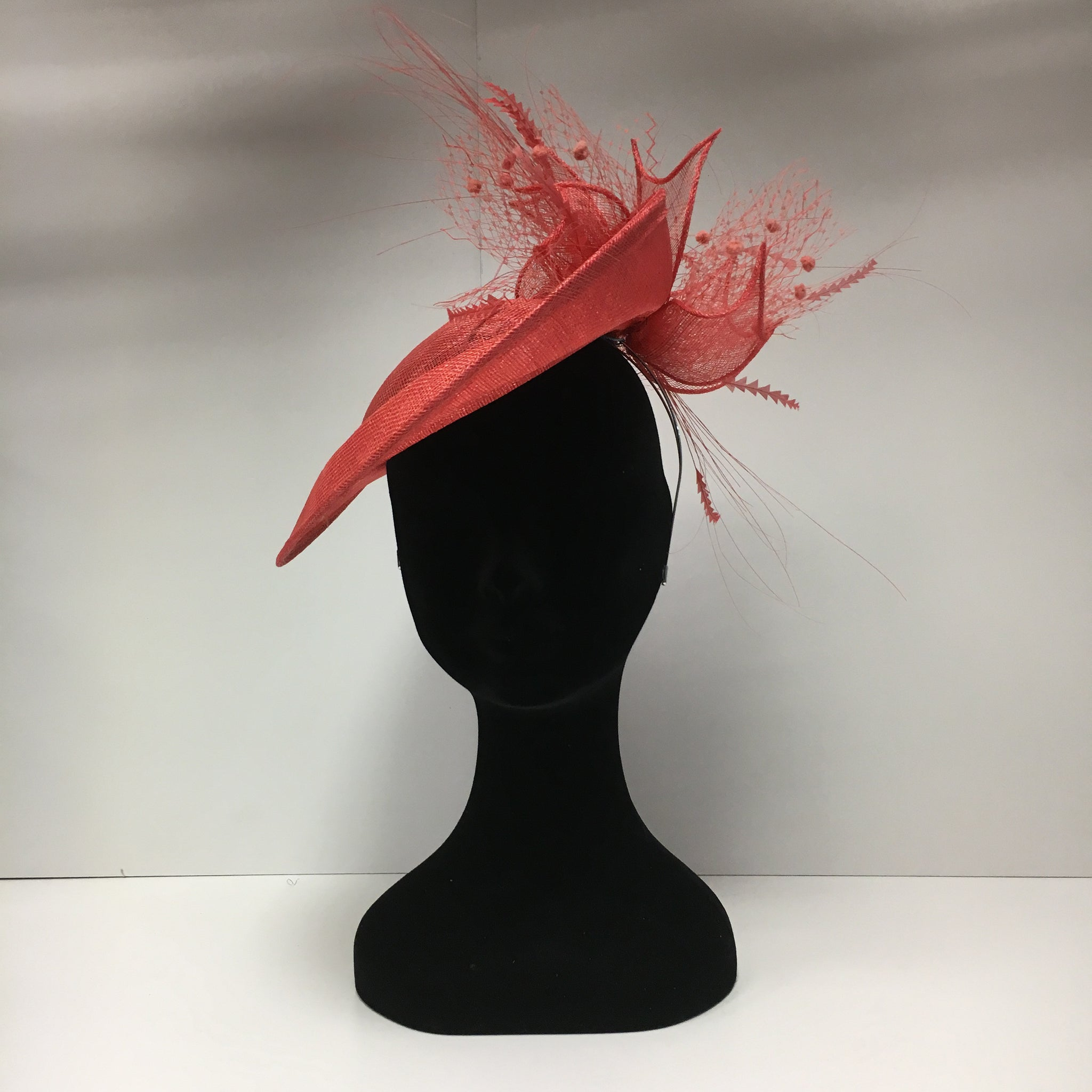 hat hire, fascinators for hire, fascinators, coral headpiece, hat hire epsom, cheap hat hire