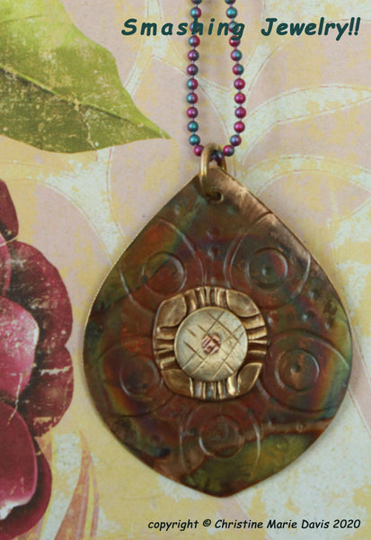 Rainbow Teardrop Assemblage Pendant with Smashed Buttons, Brass Stamping with a multicolored Patina
