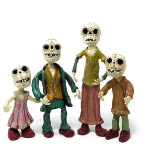 A Sugar Skull Family of Skeleton Sculptures
