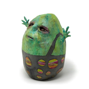 Billi Bot, is a one-of-a-kind, hand sculpted and painted sculpture of a round eggshaped little fella sporting polka dot dungarees.
