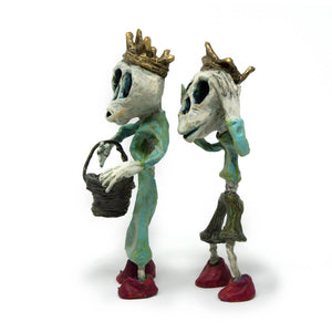 Jack and Jill, are each one-of-a-kind, hand sculpted and painted sculptures of the skeleton duo proudly donning their gold crowns and red shoes, while Jill carries the pale.