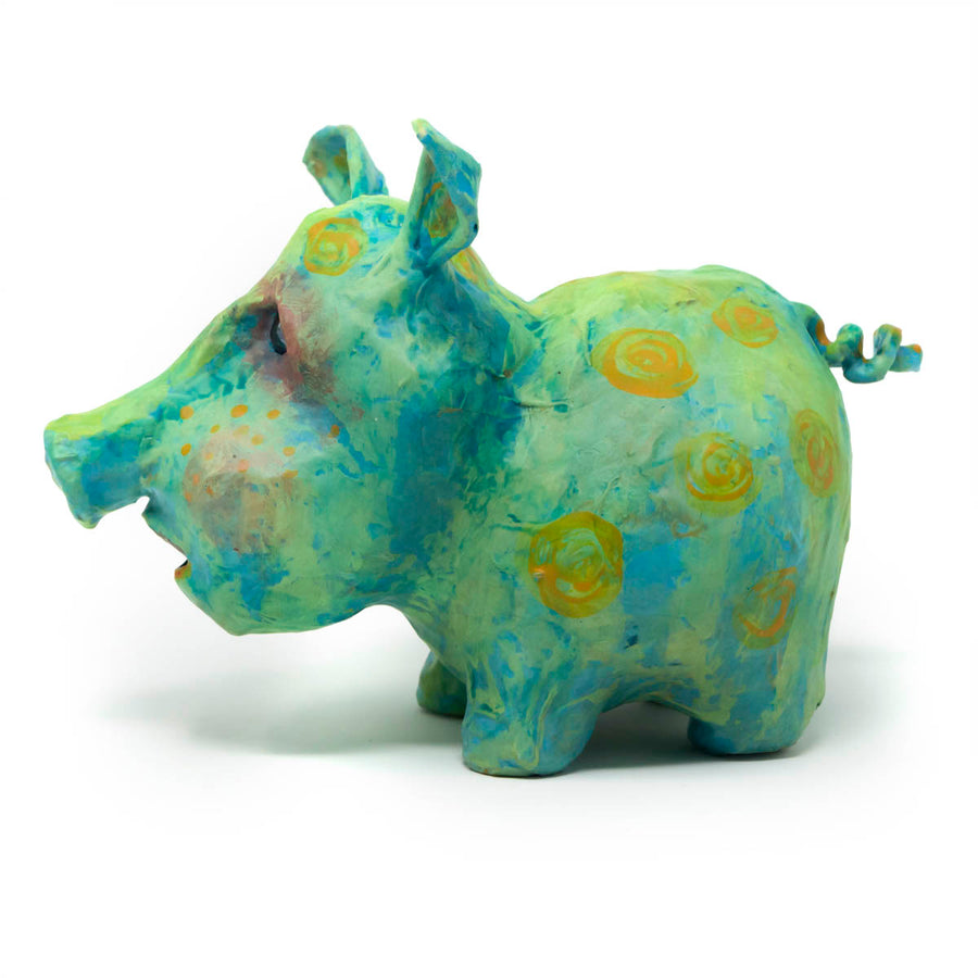 Mack is a one-of-a-kind, hand sculpted and painted sculpture of a blue and green pig with yellow accents and dark glass eyes.