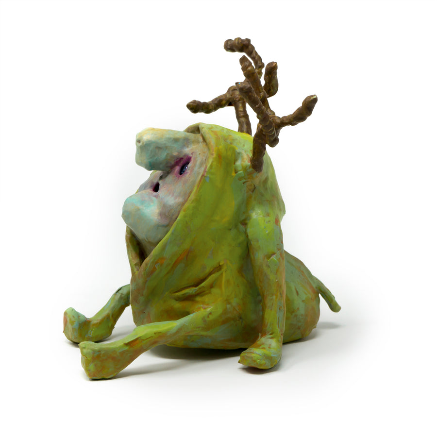 Shelton, is a one-of-a-kind, hand sculpted and painted sculpture of an antlered forest imp sporting a lime colored hooded onsie.