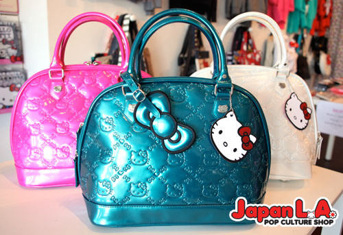 5254c60ee Our embossed bags (teal, white, and pink) have been marked down to $50!  Take 25% off select totes, Hello Kitty backpacks, wallets and necklaces! Don't  miss ...