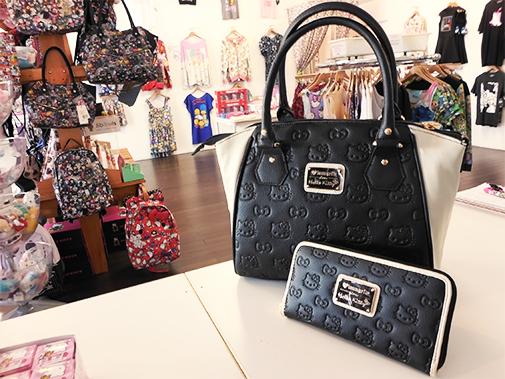 All Loungefly items available online and in-store. This Loungefly Hello  Kitty Black Cream Purse has a matching wallet that is too cute to boot. eb3636047b382