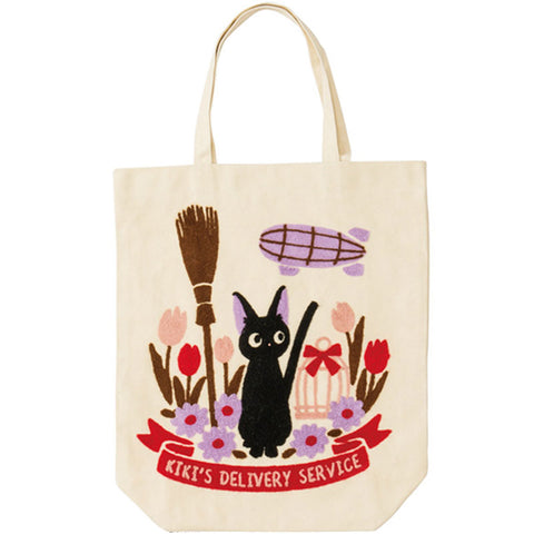 Jiji in a Field with Broom Tote Bag