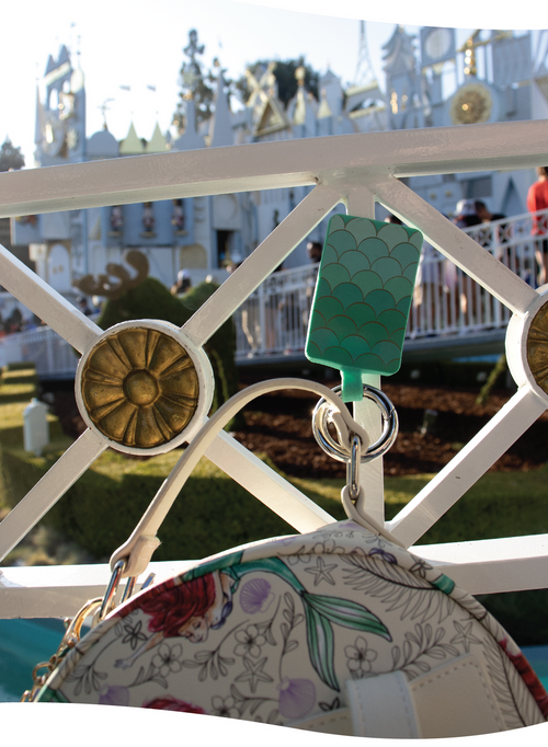 Siren Bagnet attached to metal fencing at Disneyland