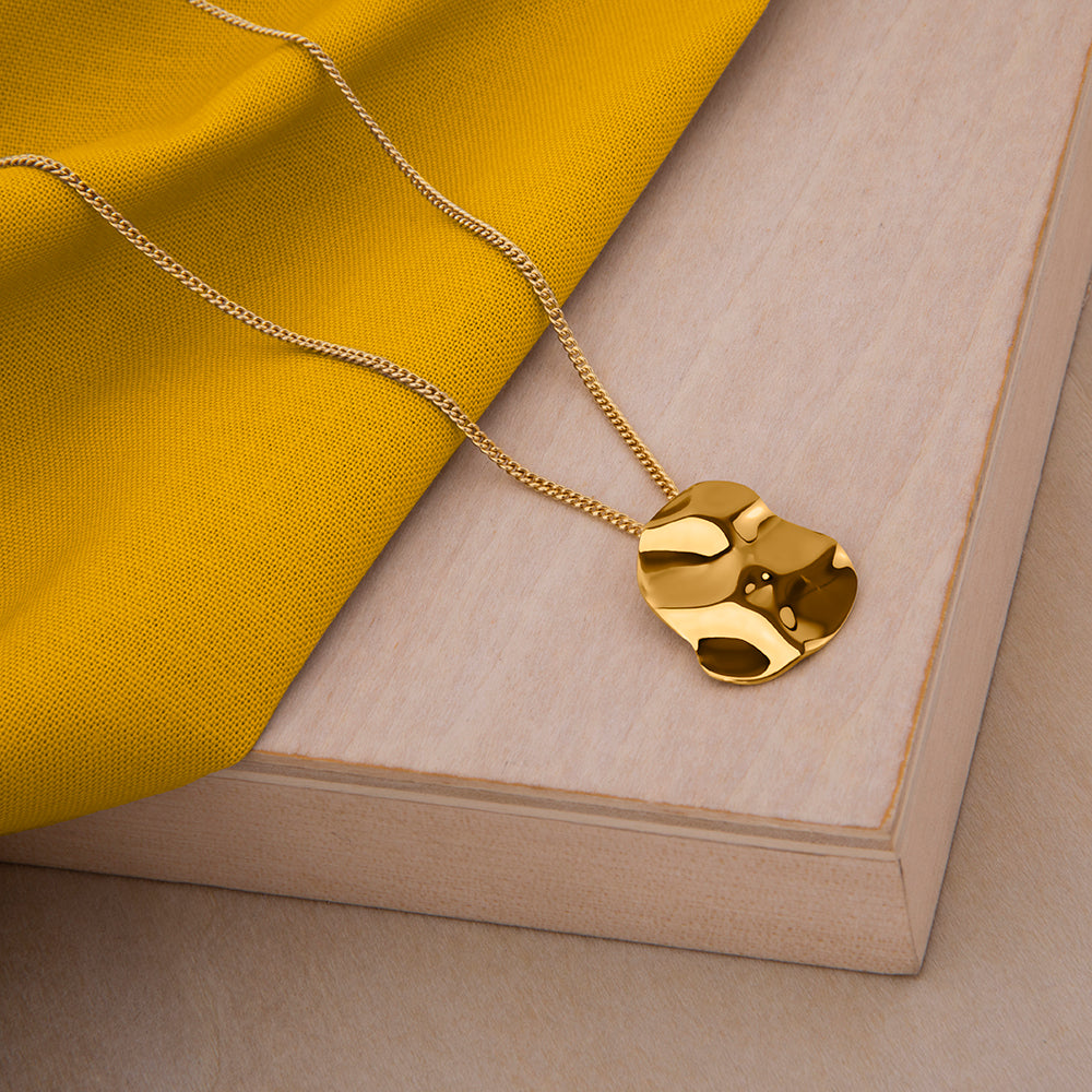 Republic Road Mirer Marvel Necklace in Gold on Wood