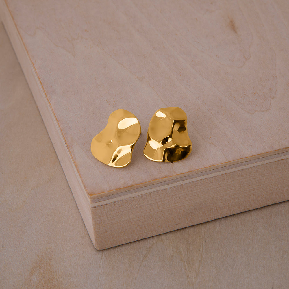 Republic Road Mirer Marvel Studs Gold on wood