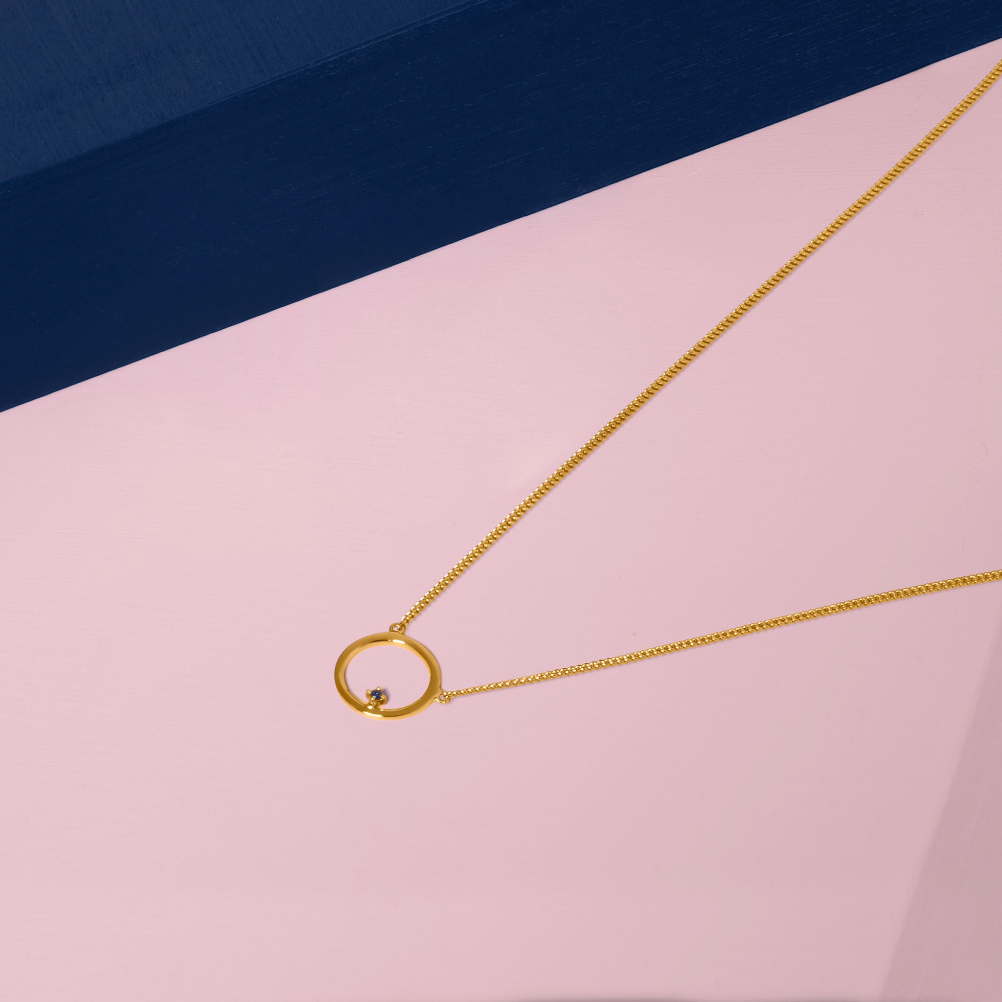 Free To Roam Necklace Gold Styled On Pink and Blue
