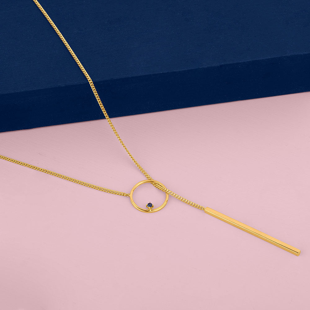 The Guide Lariat Necklace Gold on Pink and Blue