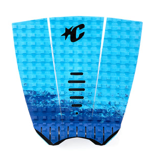 Creatures Mick Fanning Traction Pad - Cyan Fade Black, Surf Accessories, Creatures of Leisure, Creatures of Leisure, Traction Pads, Mick Fanning's Signature 3-piece traction pad is designed with lightning speed surfing in mind. No dye cut holes for reliable all-over traction. 7mm Tear-Drop Arch with the Chisel Cut construction, Square-Loc traction pattern and 28mm Table Top kick. Also featuring 3M Adhesive backing and the exclusive Creatures lightweight premium EVA formula.