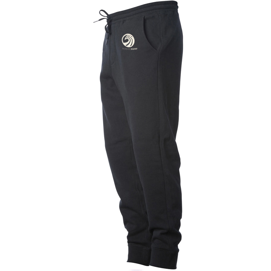 Seaside Surf Shop New Wave Sweatpants - Black, Apparel, Seaside Surf Shop, Mens Sweatpants, Seaside Surf Shop Sweatpants. Midweight Fleece Pant is made with 8.5oz 3-end Fleece in a relaxed fit. We use premium ring-spun cotton to achieve a smooth and stable fabric surface for printing. Completed with our quality construction, elastic waistband with shoestring drawcord, sewn eyelets, sewn fly detail, back pocket, jersey lined hand pockets, and 1x1 ribbing at cuffs in a relaxed fit.