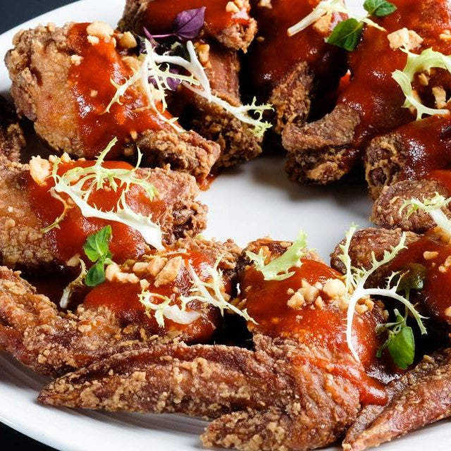 Chicken Wings with Lemon Sriracha Pepper Sauce