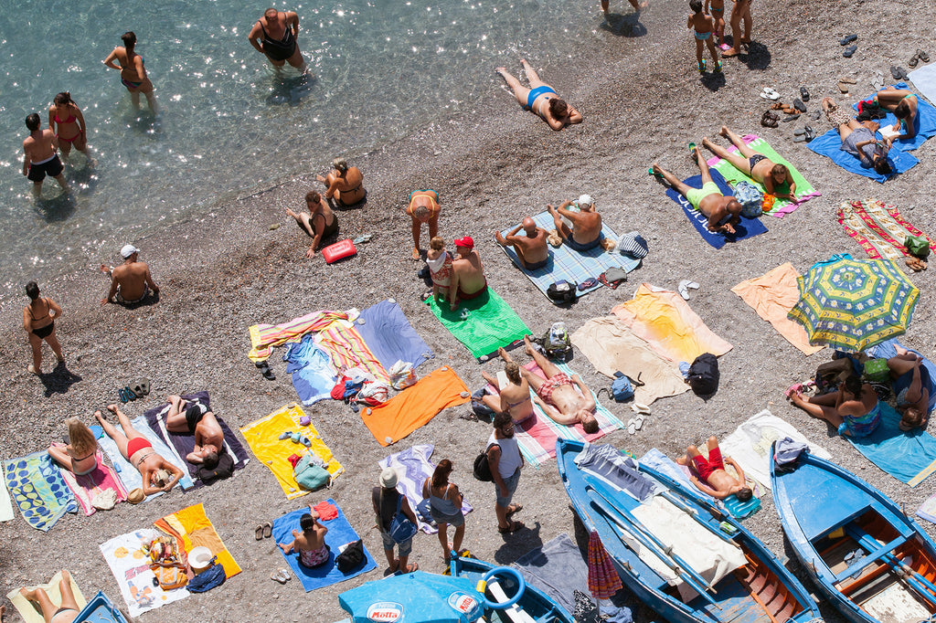 La Praia beach praiano on the Amalf Coast sunbathers amongst the boats