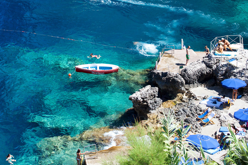 A fine art beach print of beautiful crystal blue water at Da Luigi beach Capri Italy by Carla Coulson