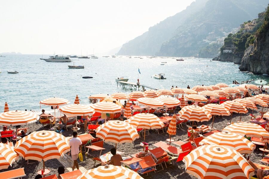 orange and white beach umbrellas on arienzo beach the amalfi coast by Carla Coulson