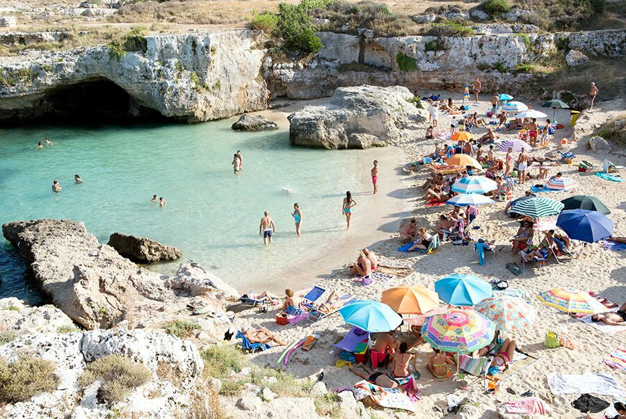 a pastel coloured fine art beach photo of cala del paradiso in monopoli puglia by carla coulson