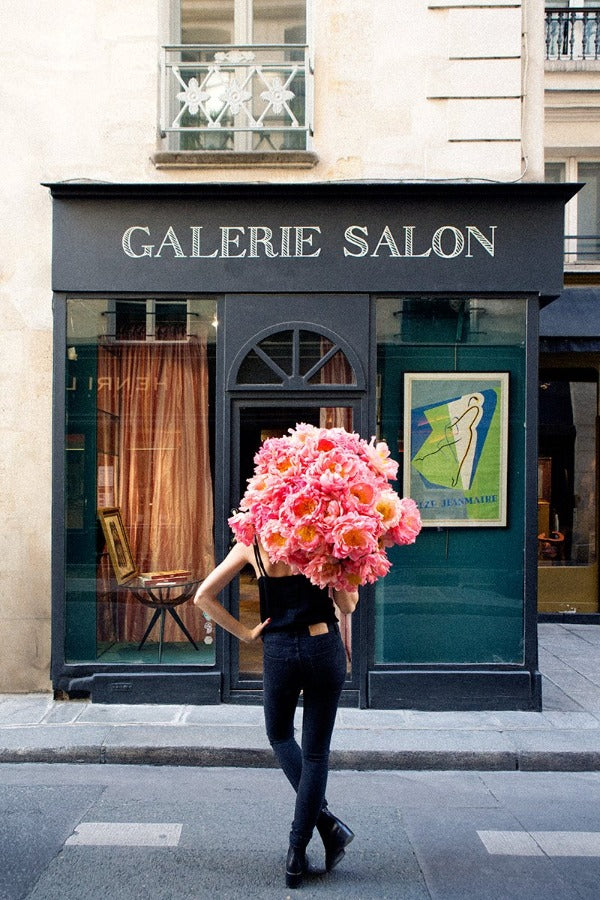 I Believe In Me is a photo of a girl in St Germain des Prés in Paris with a big beautiful bunch of peonies and is part of a limited edition series named Young Girl in Bloom by photographer Carla Coulson celebrating women loving and believing in themselves and building their self esteem by trusting their intuition.