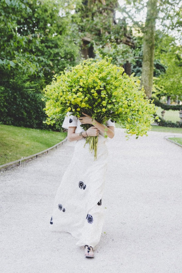 Wild Child is a photo of a girl in Jardin du Luxembourg in Paris with a beautiful bouquet of green blooms and is part of a limited edition series named Young Girl in Bloom by photographer Carla Coulson celebrating women loving and believing in themselves and building their self esteem by trusting their intuition.