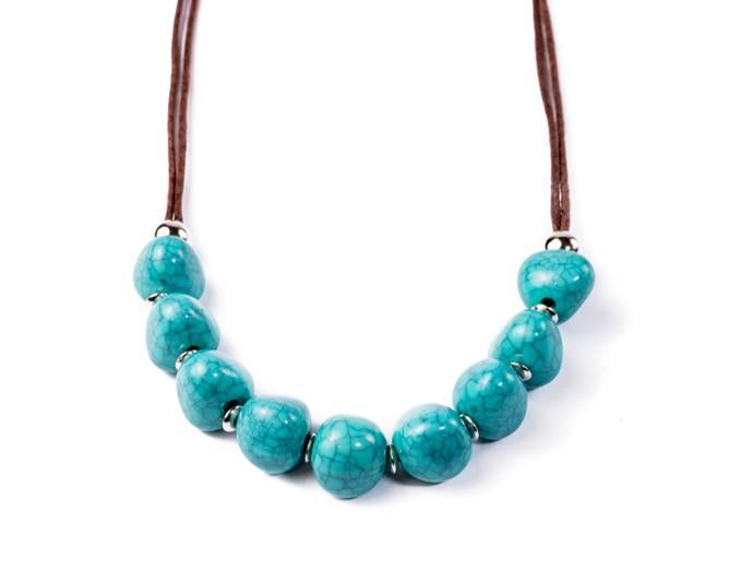 turquoise necklace round Pebbles