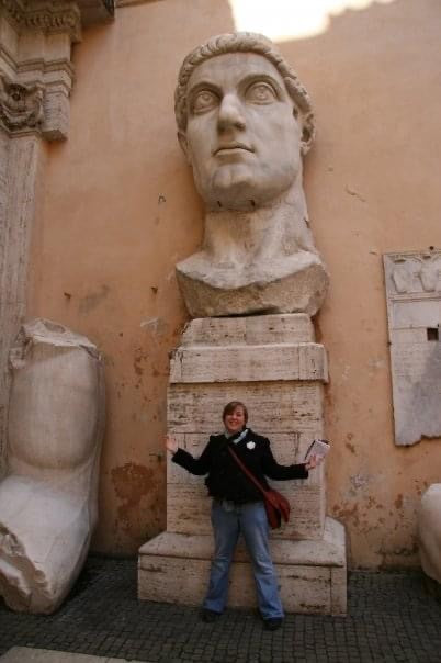 Photo of Jennifer in front of a statue in Rome