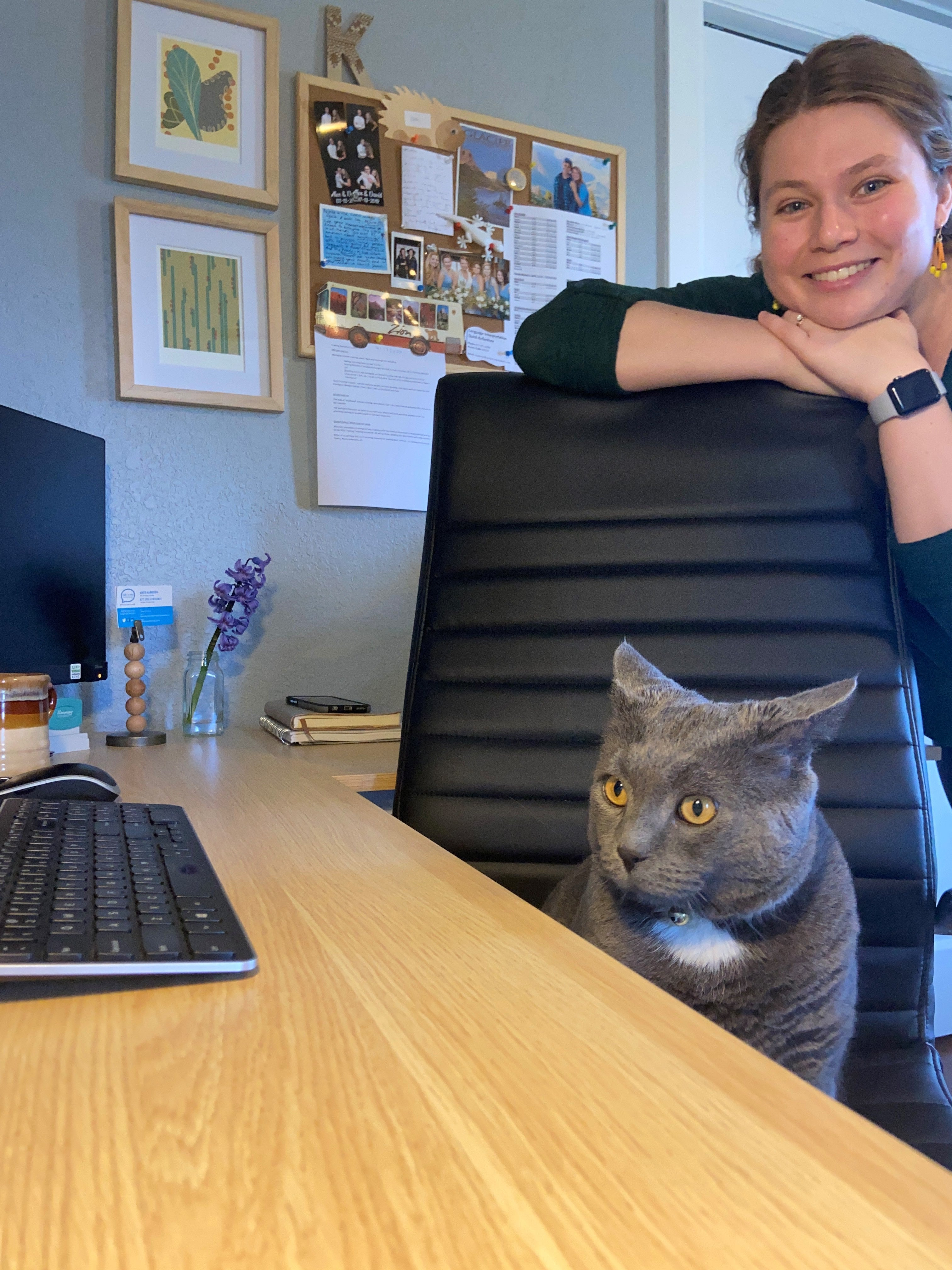 AAC Training Specialist Kate Karkosh's workspace and cat Grover