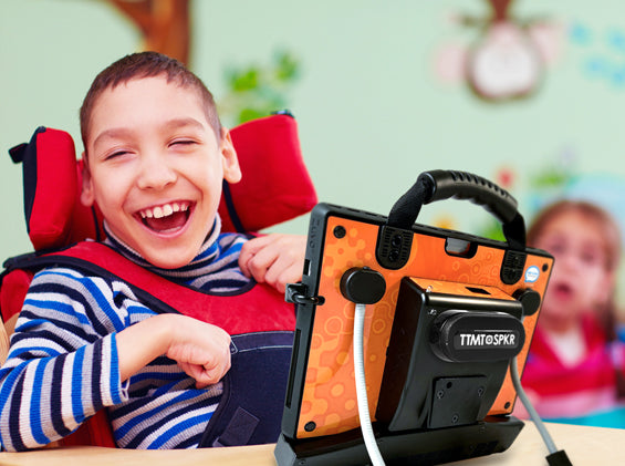 Image of smiling child with zuvo 12-D speech generating device