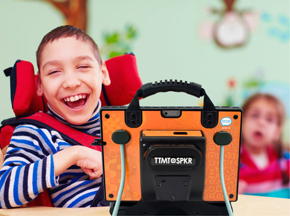 Image of smiling child with zuvo 12-D speech generating device with eyespeak and flexstand