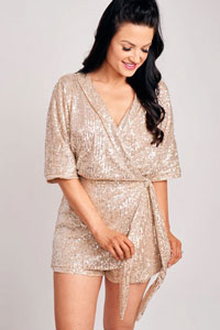 woman in sparkly sequin romper for holiday party