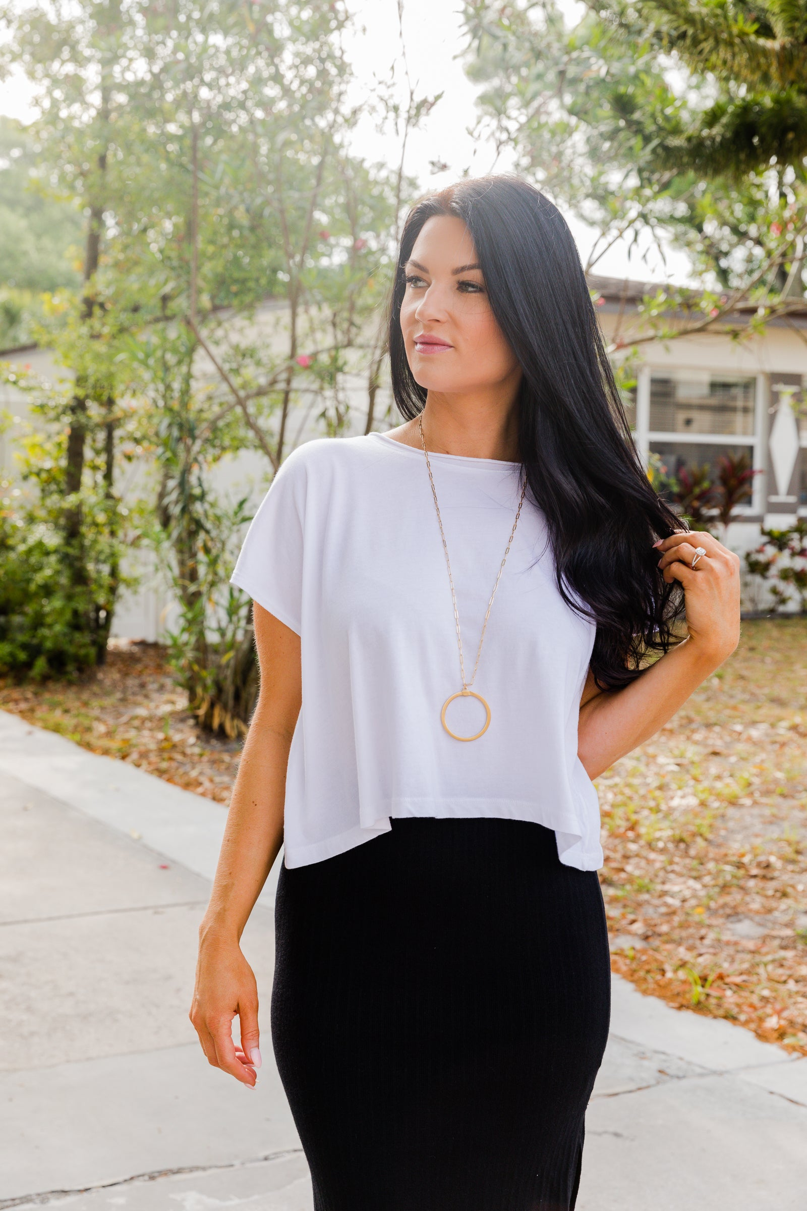 This lightweight tee has short sleeves that attach to a u-neckline on an oversized and cropped bodice silhouette.