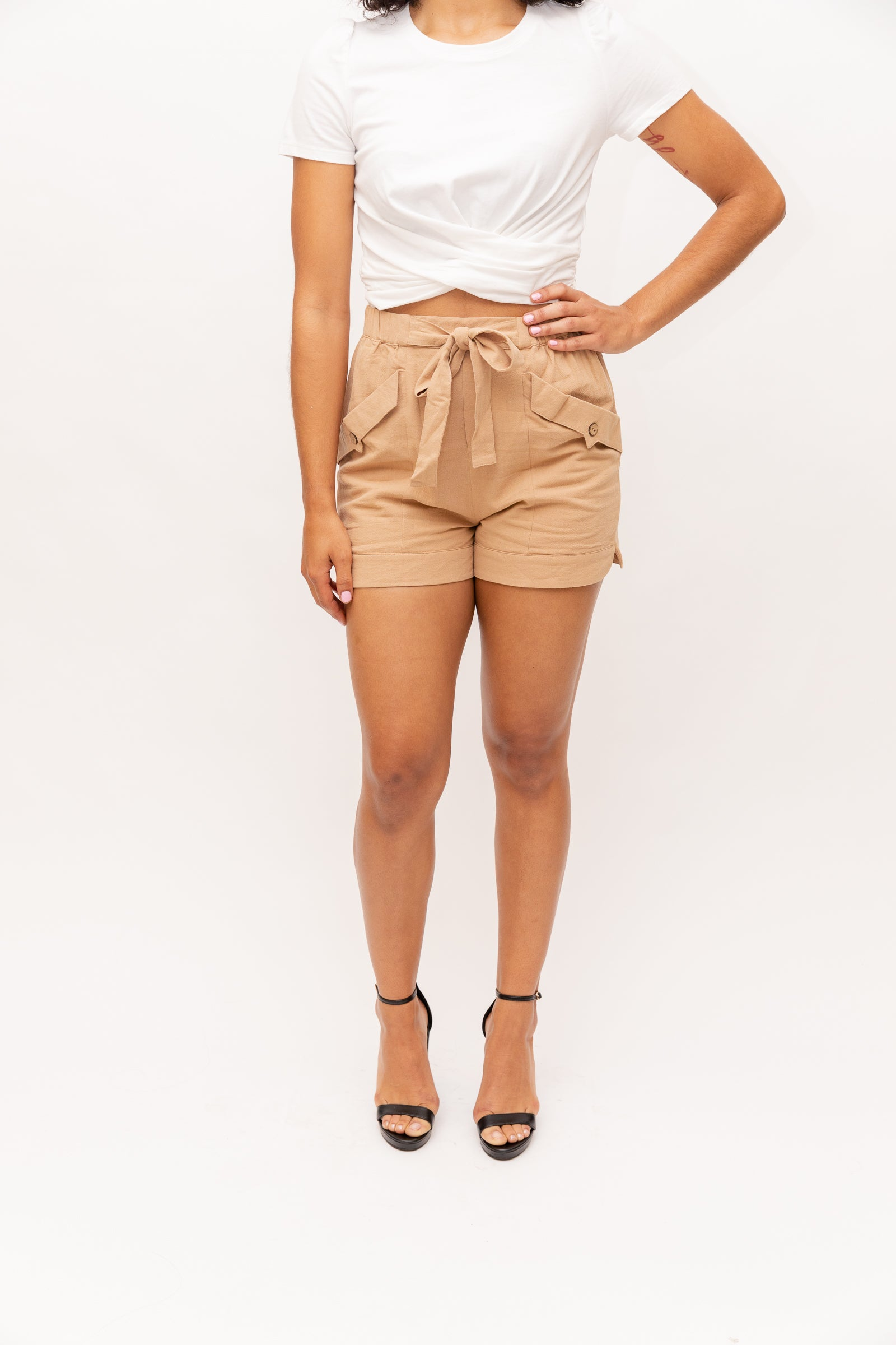 Elastic paper bag style waistband goes down to flapped and buttoned pockets then into relaxed-fit shorts. These casual shorts feature a fabric tie to wind through the belt loops and to cinch the waist.