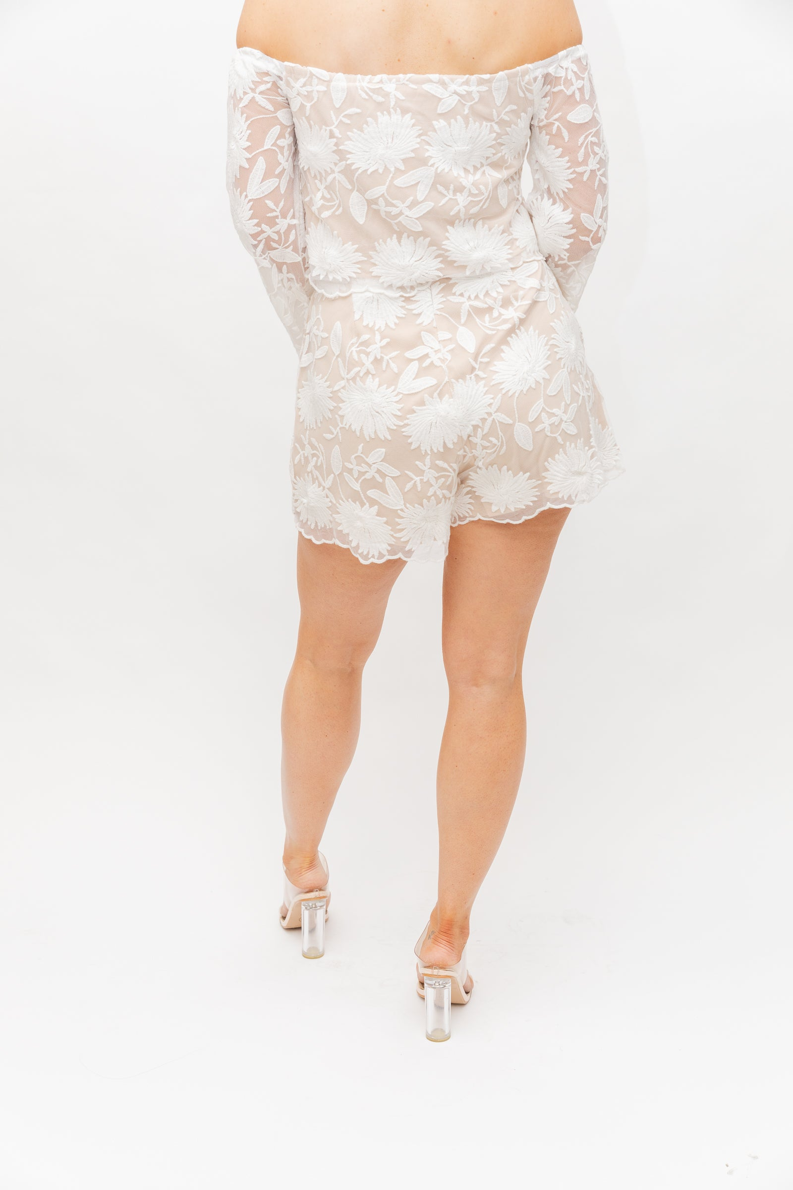 Gorgeous white lace overlays the tan fabric of these shorts. It has a fitted waistband and goes down into relaxed shorts with a scallop hem.