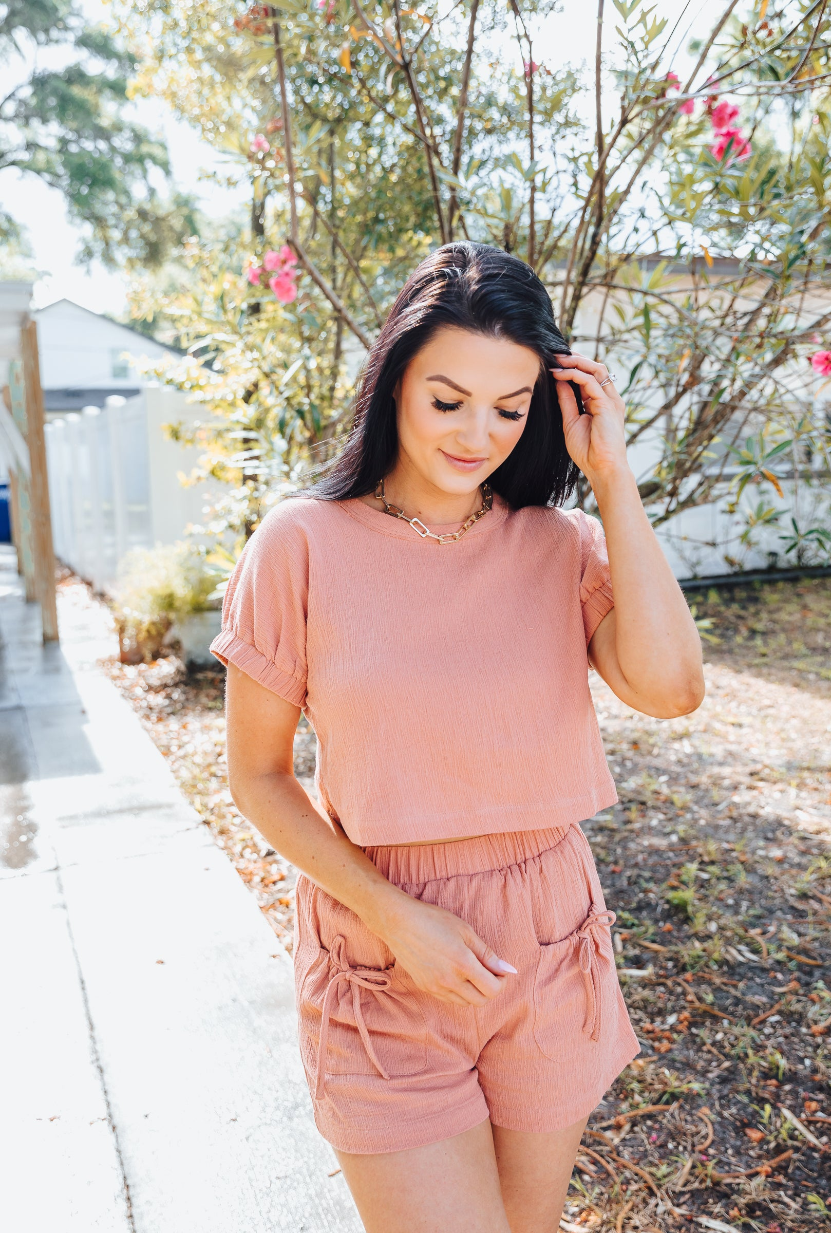 Keep it comfy and cool while lounging around at home while in the Tanya Tee! Short sleeves attach to a high u-neckline on a relaxed fit and cropped bodice silhouette.