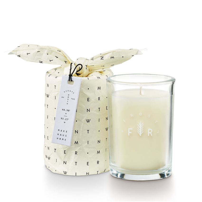 Wrapped in an adorable paper bag and hang tag, this simply designed glass candle is perfect for gifting.