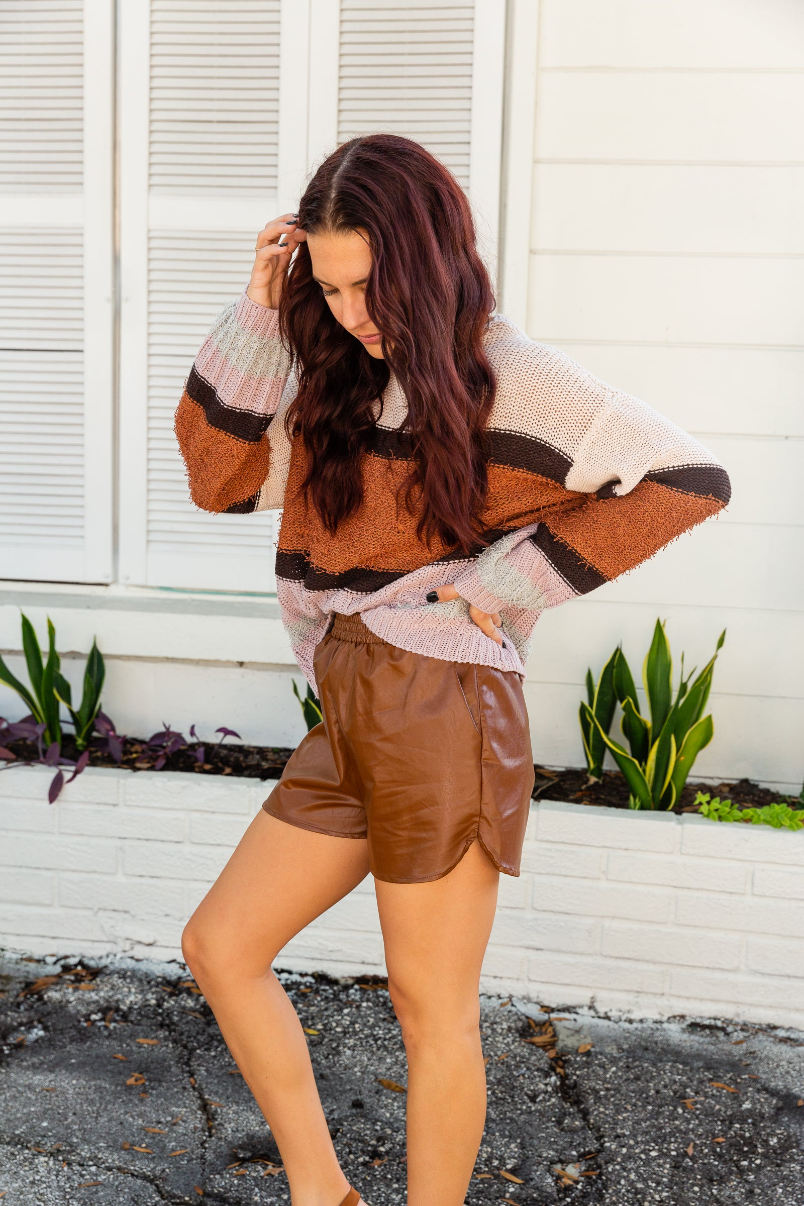 These pleather shorts have an elastic waistband and go into loose-fitting relaxed shorts. Style these vegan leather shorts with a cropped sweater.
