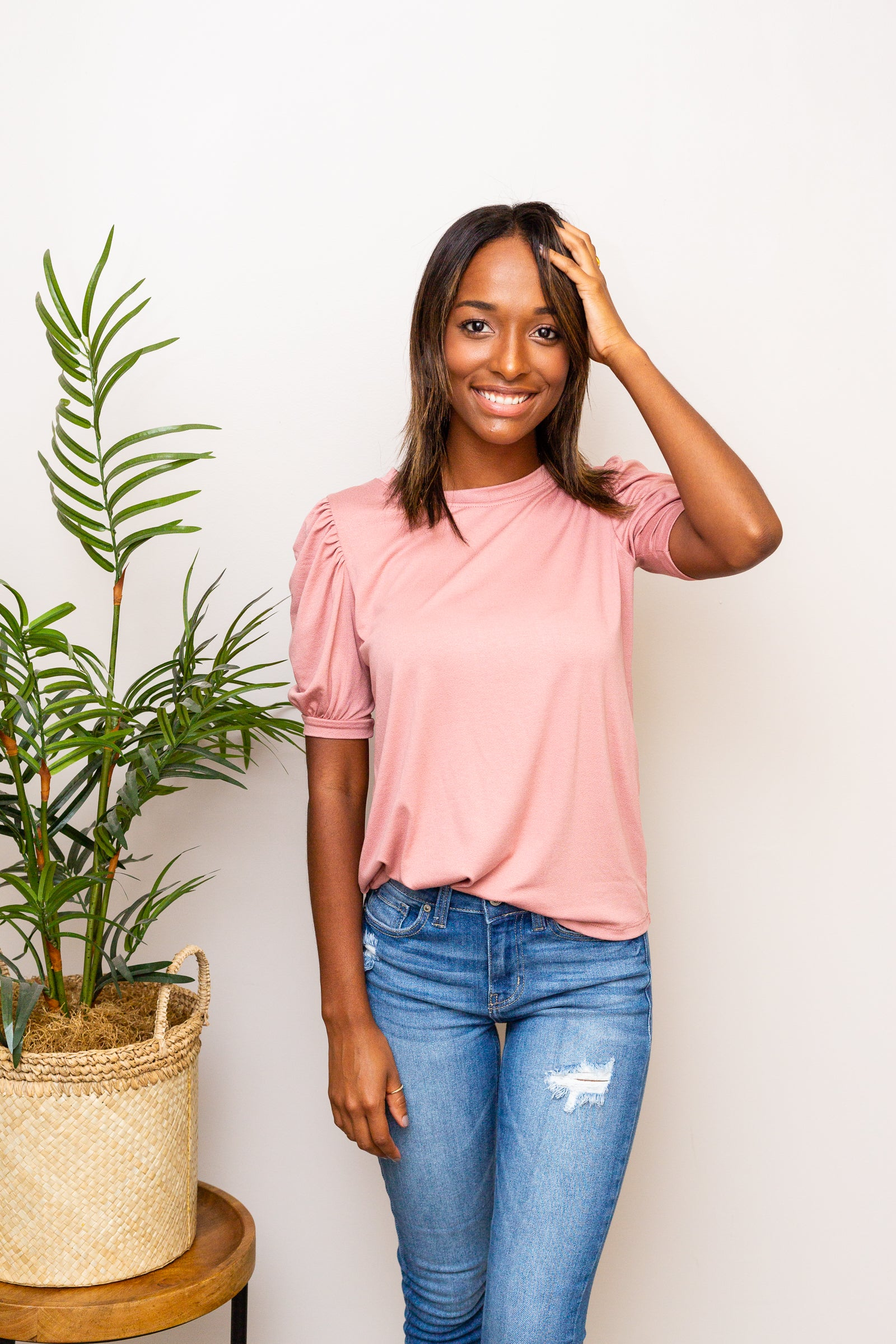 This mauve t-shirt has short puff and banded cuffed sleeves that attach to a banded u-neckline on a relaxed-fit bodice silhouette.