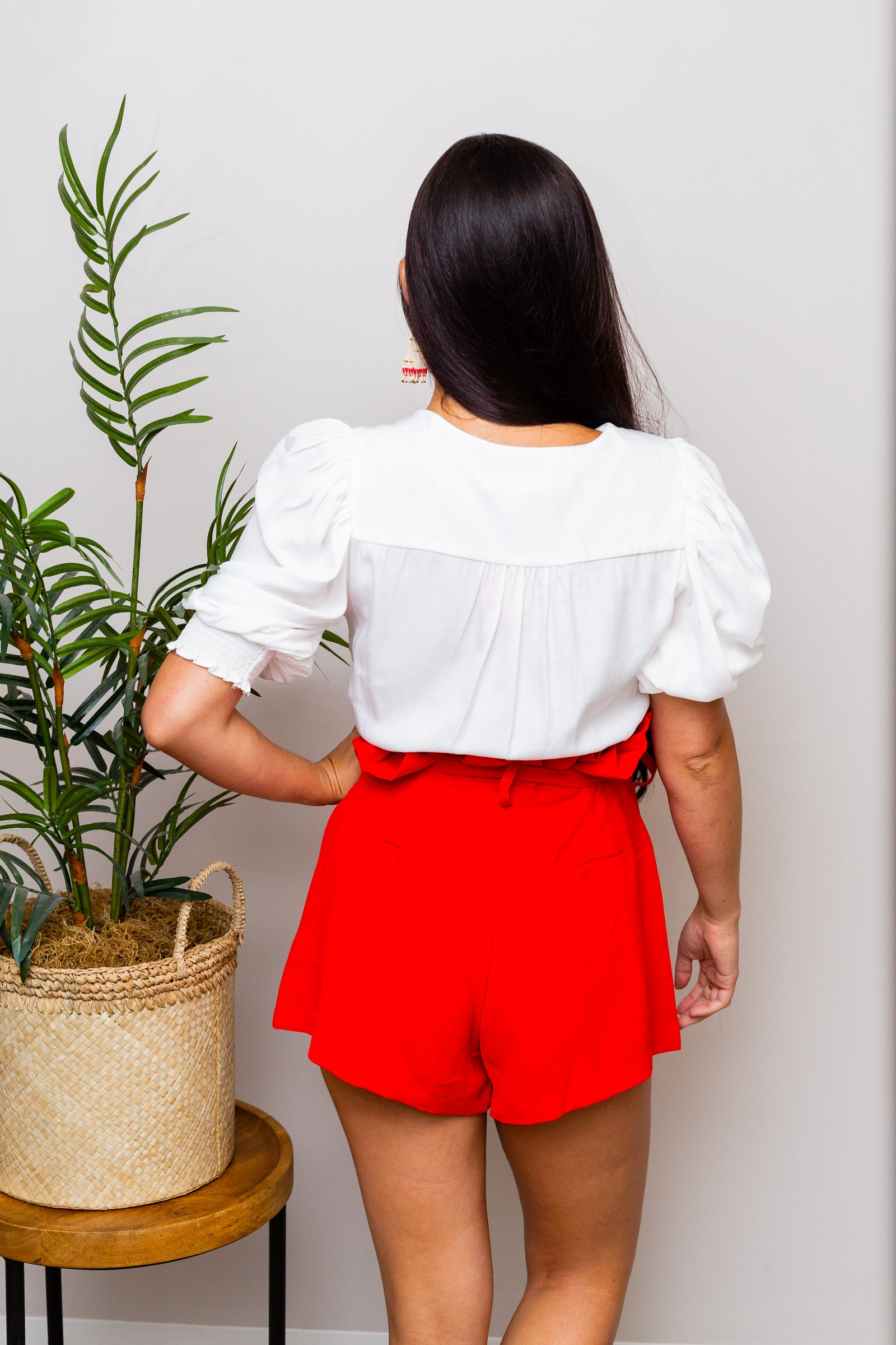 Paper-bag style hem before leading to a fitted waistband with belt loops and leading hook clasps and a zipper fly and flow into comfortable shorts with prominent square pockets on the side.
