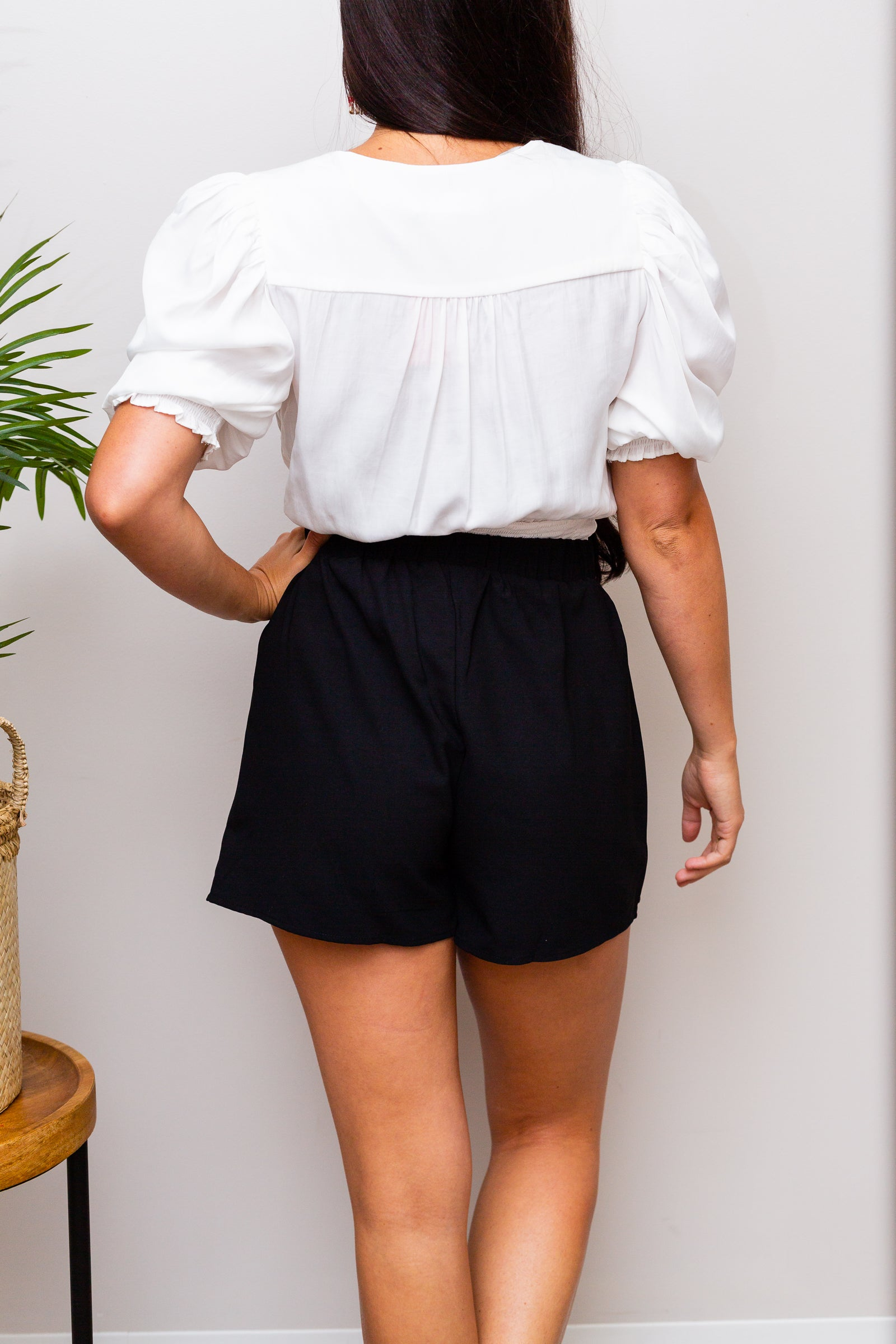 This classic skort has a fitted elastic waistband that leads down to an asymmetric skirt panel that lays atop of relaxed-fitting shorts.