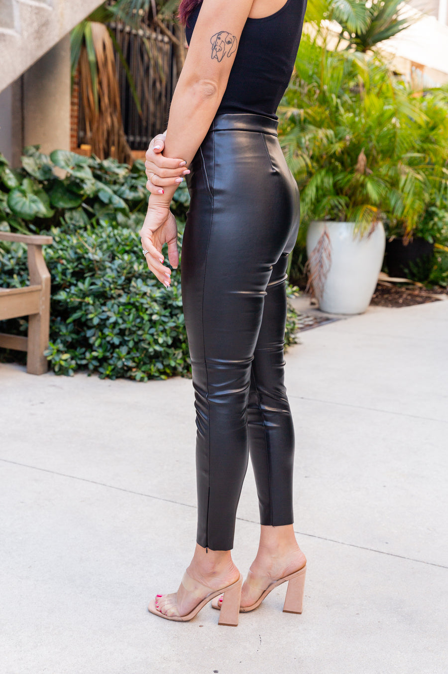 These pleather pants have a fitted waistband with a button and zipper fly and go into fitted and sleek skinny pant legs. Style these faux leather pants with your favorite cropped band tee.