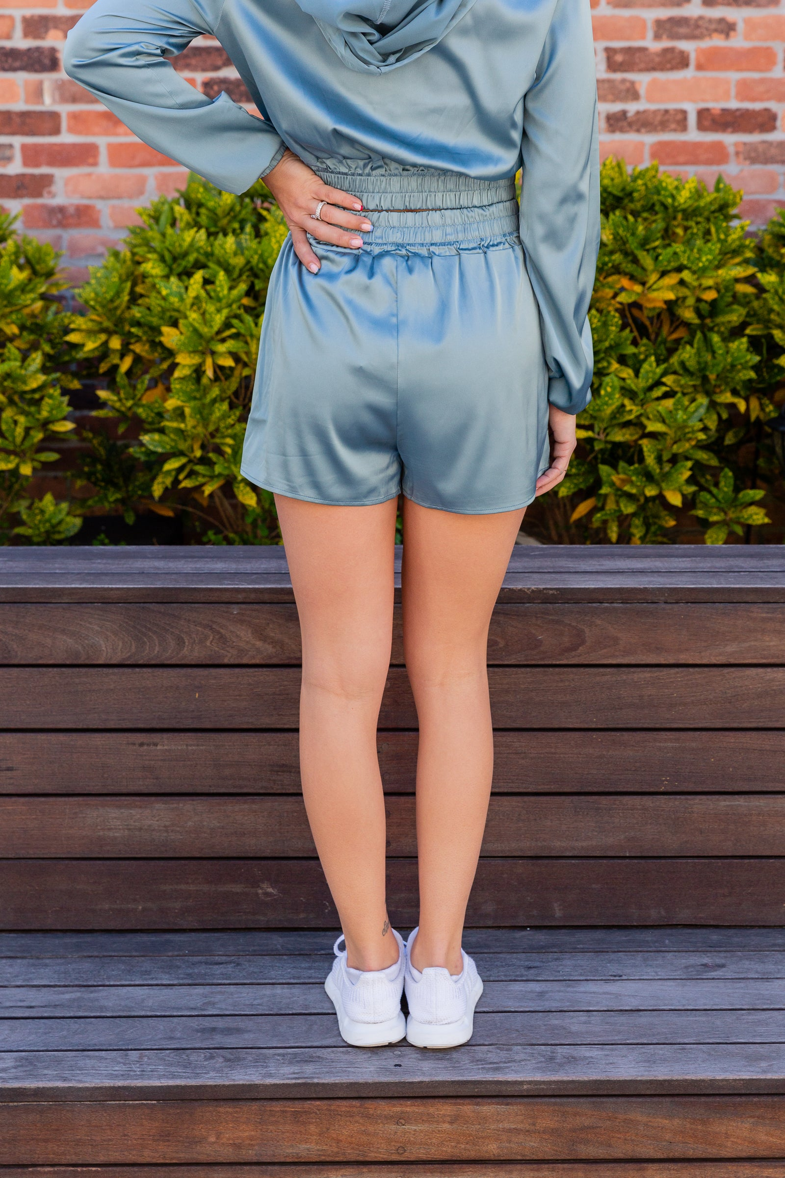 These satiny bottoms have an elastic waistband leading to side pockets on relaxed and comfortable shorts.