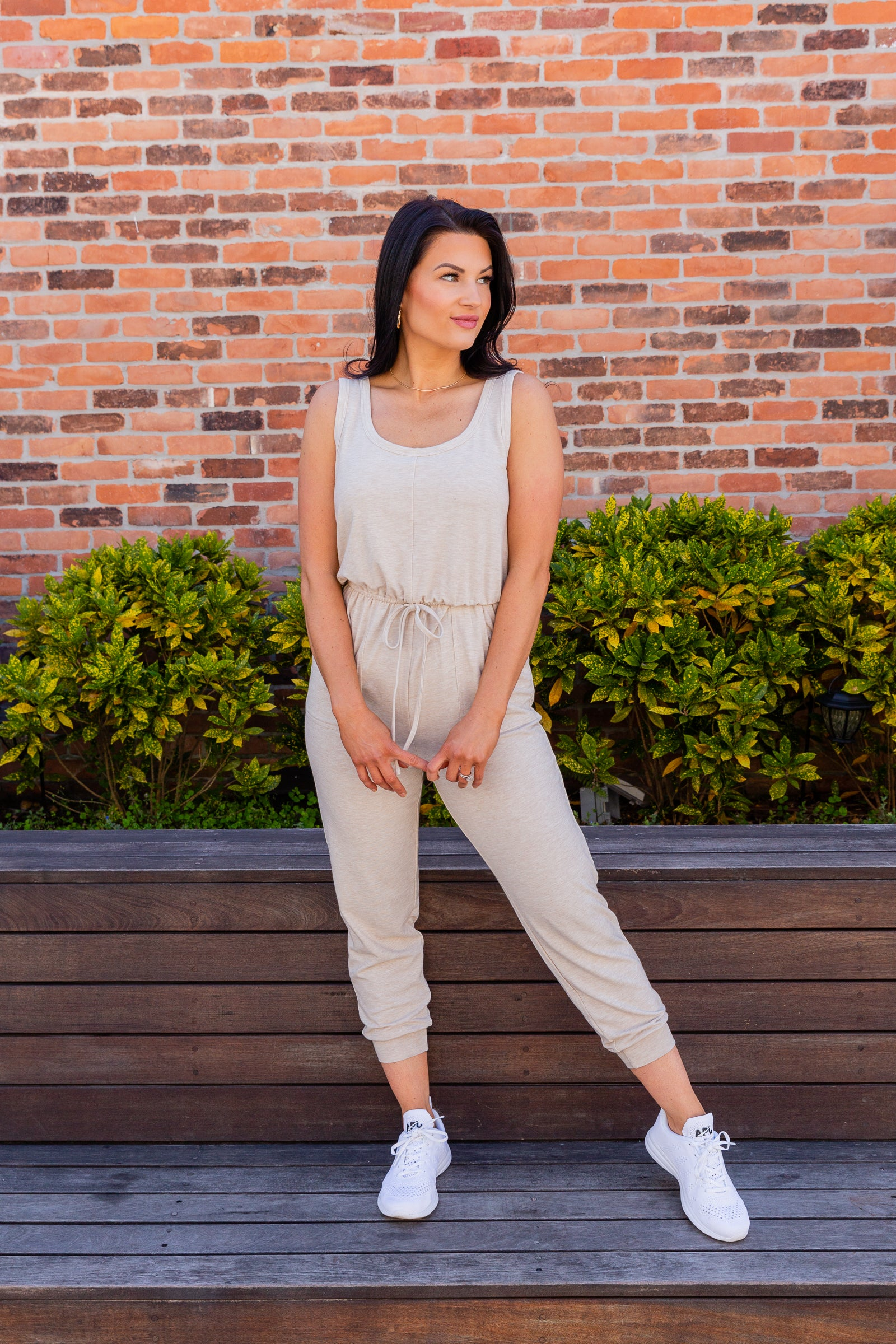 This sleeveless jumpsuit has medium straps that attach to a u-neckline on a relaxed-fit bodice and meets an elastic waistband, tapers into skinny pant legs with a banded cuff at the ankles.