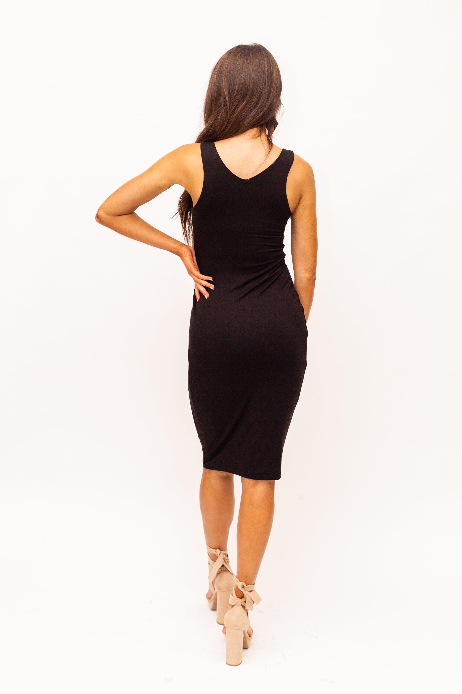 Ultrasoft and comfortable dual-layered dress. Medium straps attach to a v-neckline on a fitted bodycon bodice and skirt silhouette.