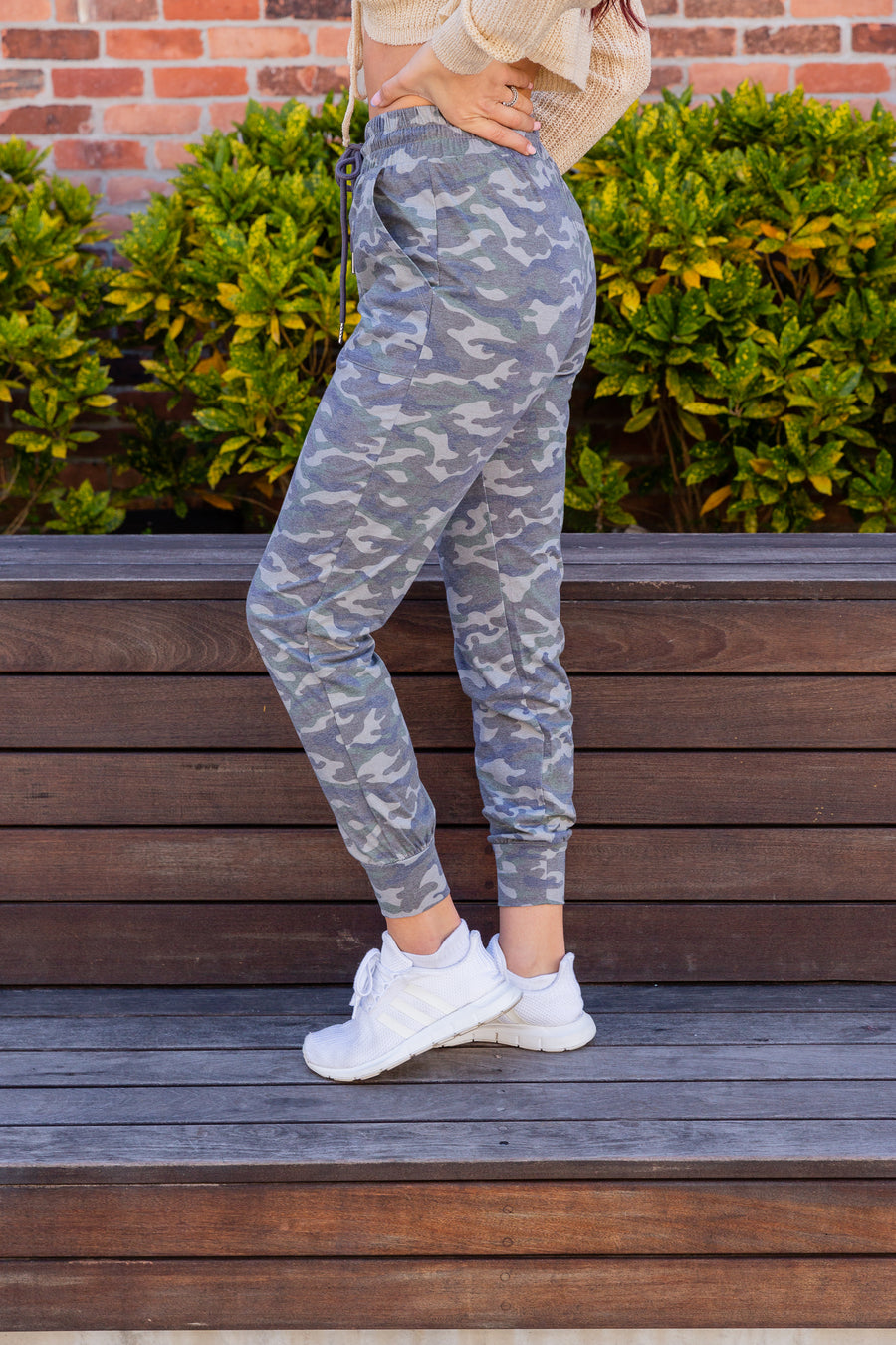 These heathered camo print joggers have a drawstring waist next to side pockets and go into comfortable fit skinny pant legs with a banded ankle cuff.