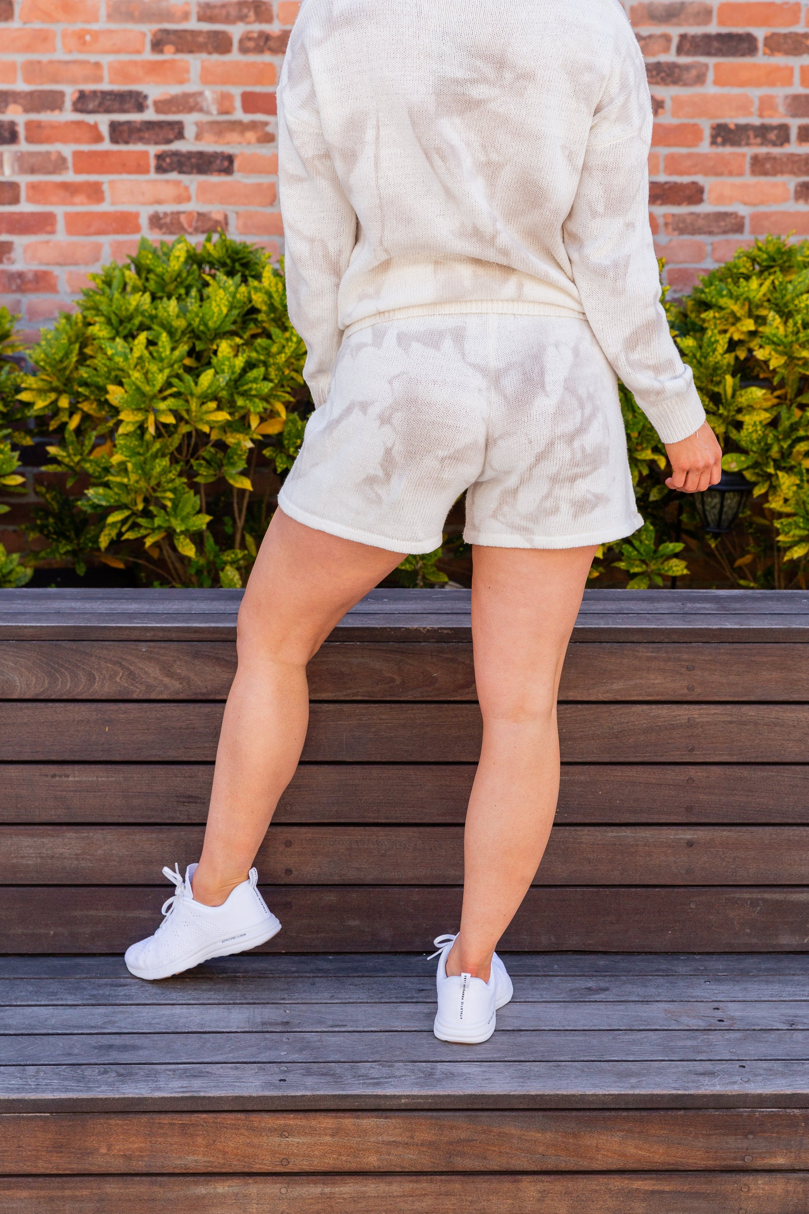 Taupe tie-dye prints cover the fabric of these lounge shorts. These comfy shorts have an elastic drawstring tied waistband that goes into oversized knit shorts.