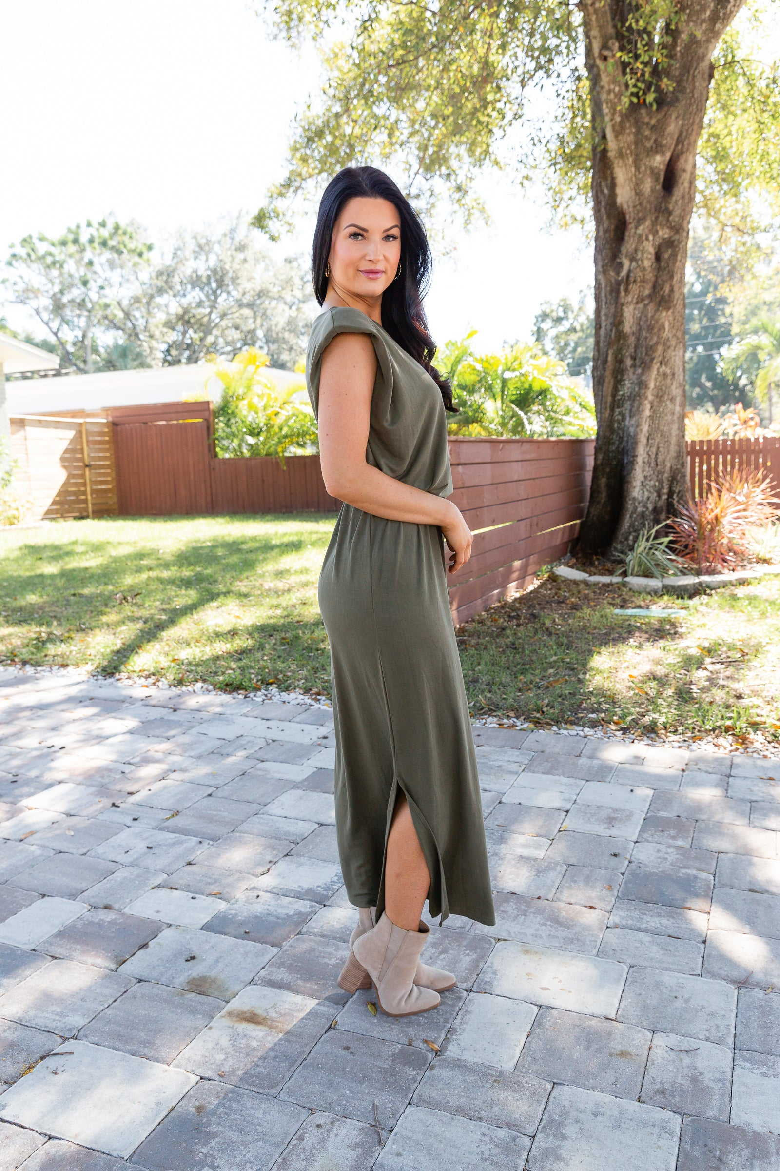 This muscle-style tank maxi dress is sleeveless with shoulder pads next to a banded u-neckline leading down to a loose and oversized dress silhouette with a clean bottom hem.