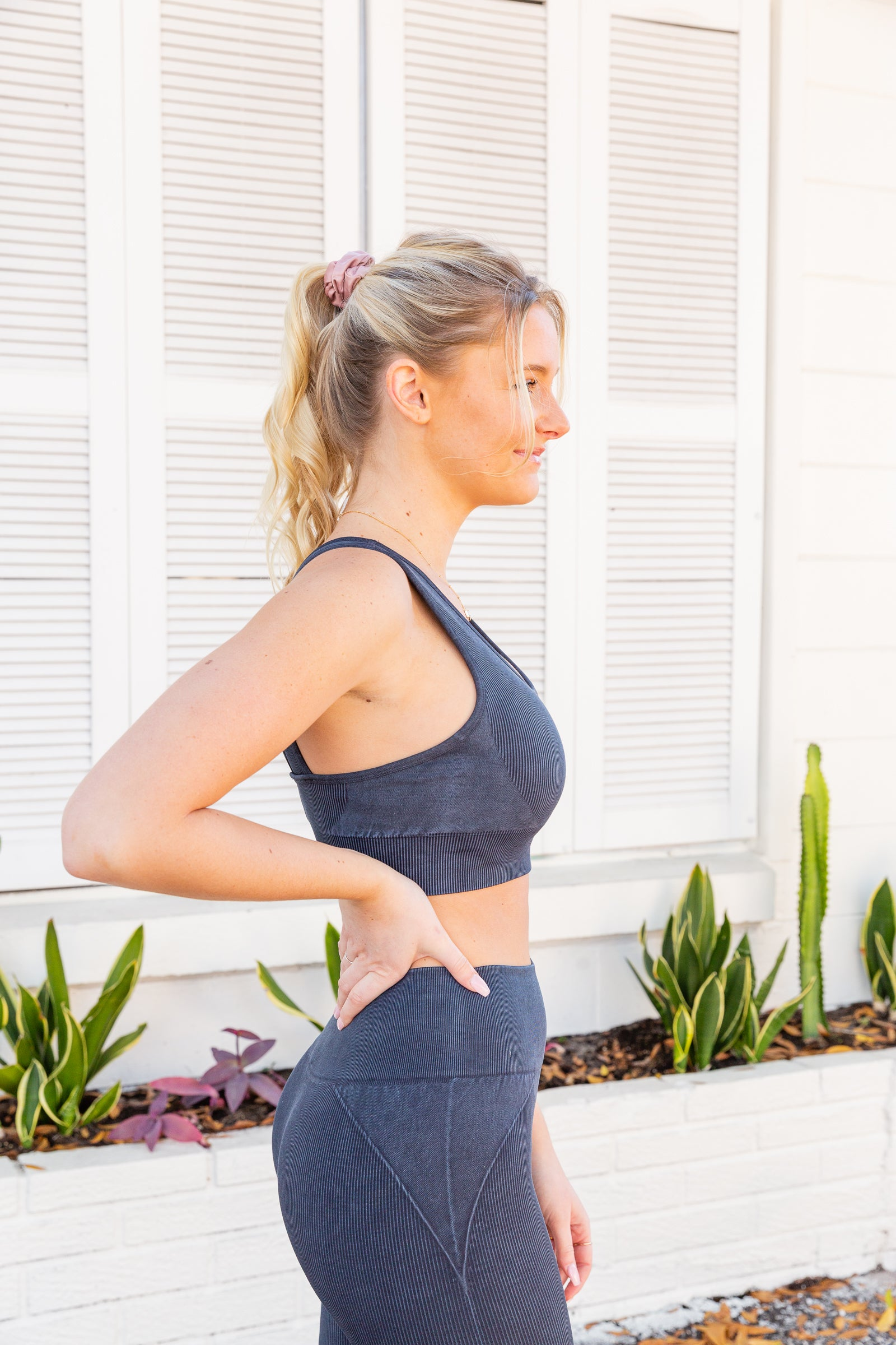 Medium straps attach to a u-neckline on comfy ribbed fabric before meeting a thick band. On the back, the ribbed sports bra's straps attach to the side to have an exposed back.