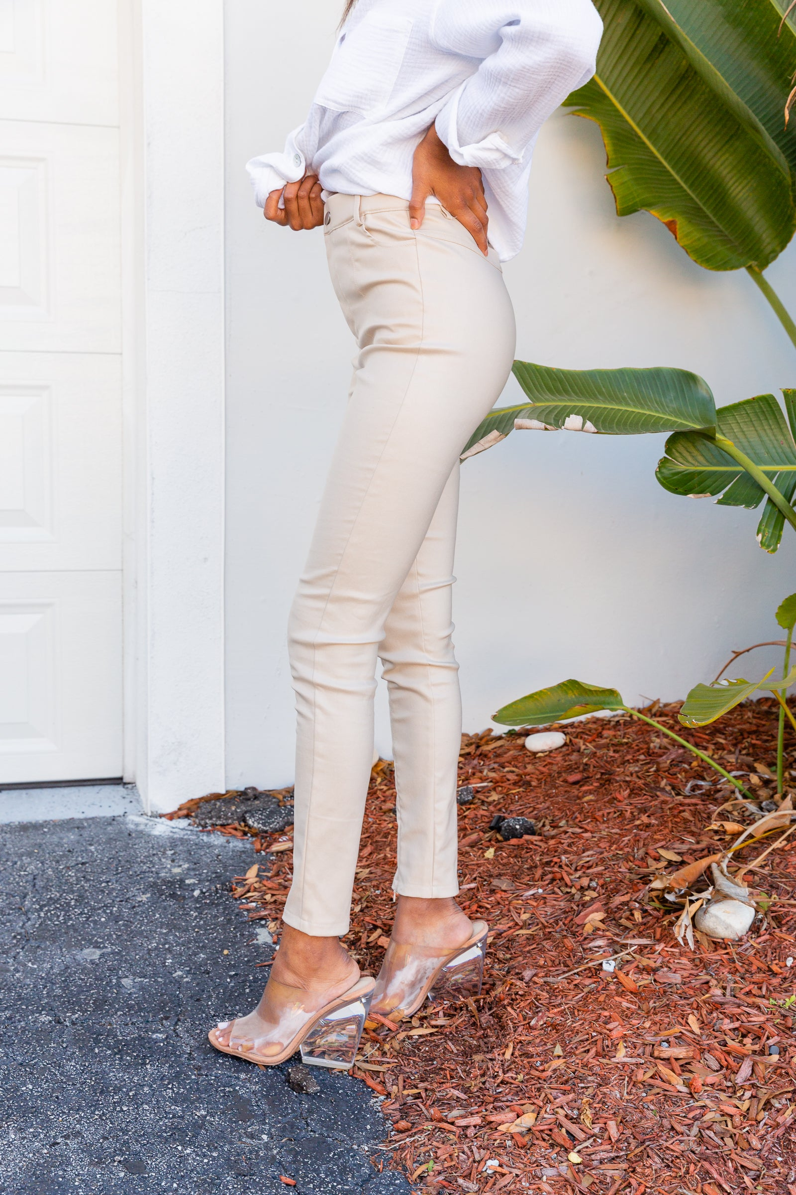 Stretchy faux leather fabric offers a mid-rise fit with button and zipper fly before going down into skinny pant legs. These jegging feature ankle zipper detailing at the center.