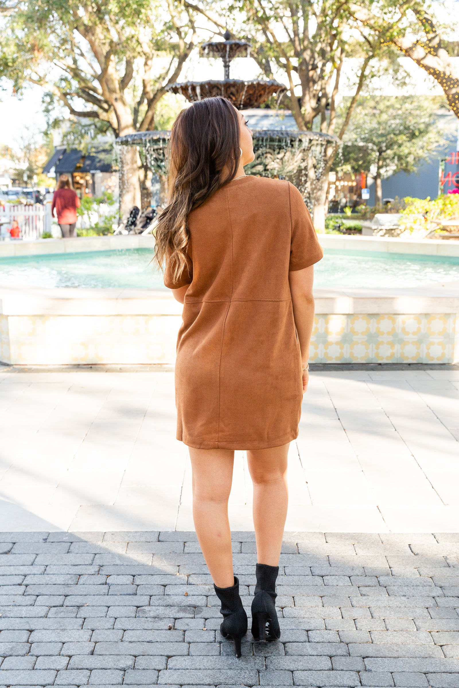 This comfortable, dual-layered dress has short sleeves that attach to a banded u-neckline and leads to a paneled and relaxed shift dress silhouette with side pockets.
